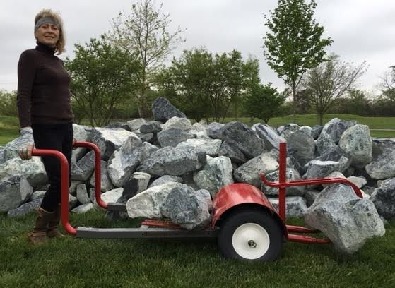 Kathy Anderson moving rocks with Rock & Debris Hauler